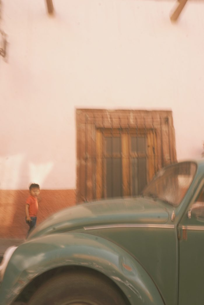 san miguel de allende - boy and voltswagen - motion photography - retro - lifestyle - street life - mexico