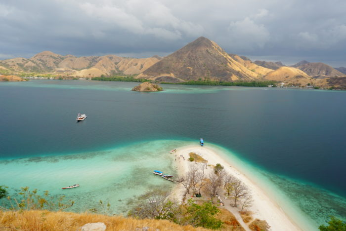 boat turquoise reef waters rinca komodo flores east nusa tenggara labaun bajo indonesia komodo island travel sailing harbor port adventure woman morning sunrise sea ocean sailing islands
